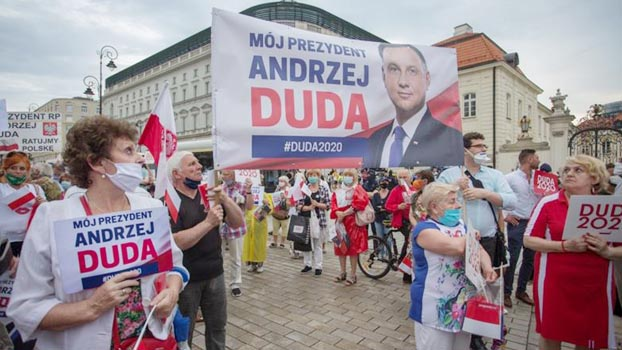 Voting begins in Poland presidential election amid pandemic ...